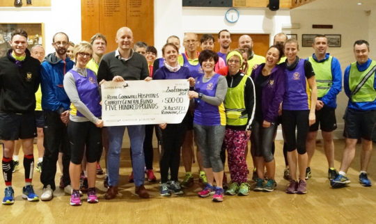 St Austell Running Club donate £500 to Royal Cornwall Hospitals Charity
