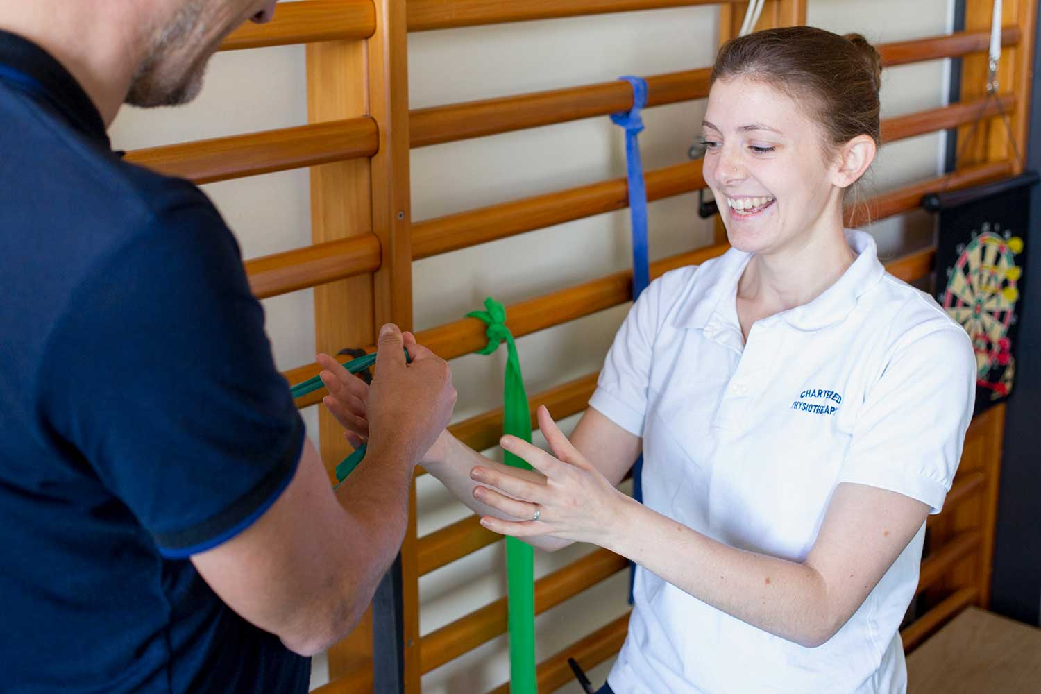 A patient smiling while doing physiotherapy