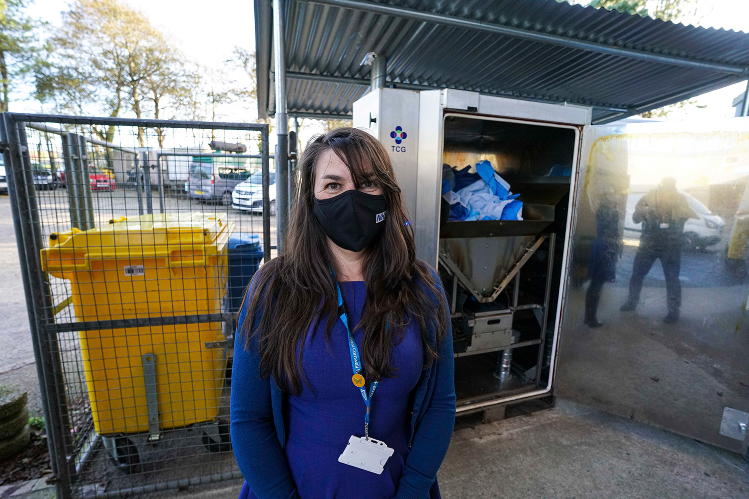 Care Group Manager Roz Davies next to the mask recycling unit
