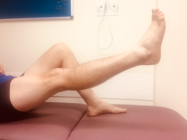 Person lifting their straightened leg and lowering it