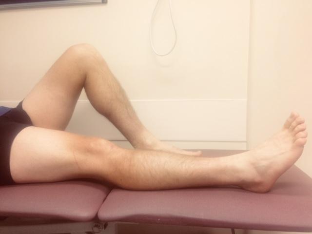 Person bending their uninjured knee and straightening their injured knee