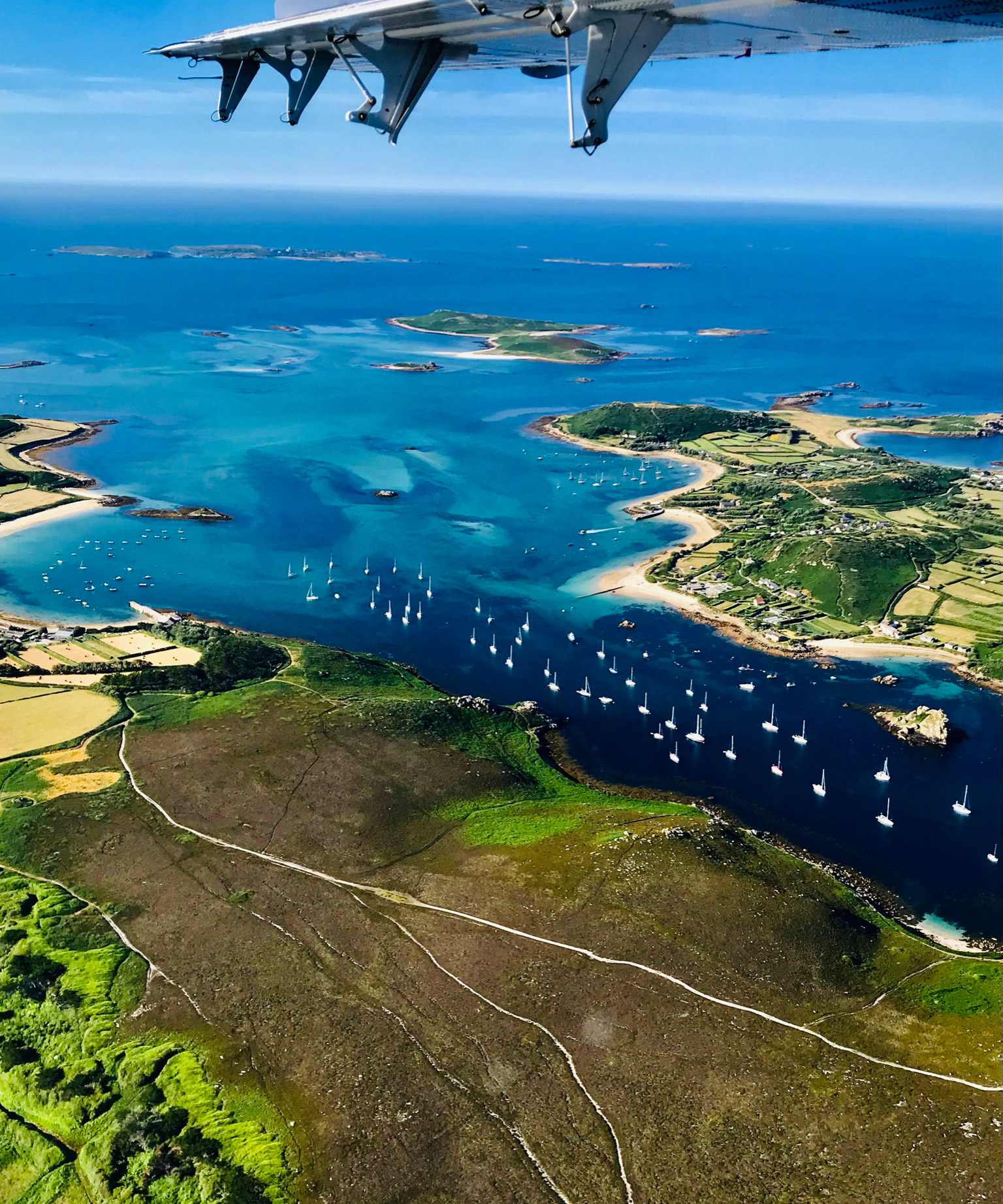 Aerial image of the Isles of Isles of Scilly and surrounding waters taken from a light aircraft