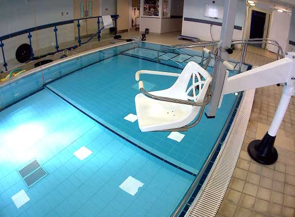 Hydrotherapy pool with chair hoist visible.