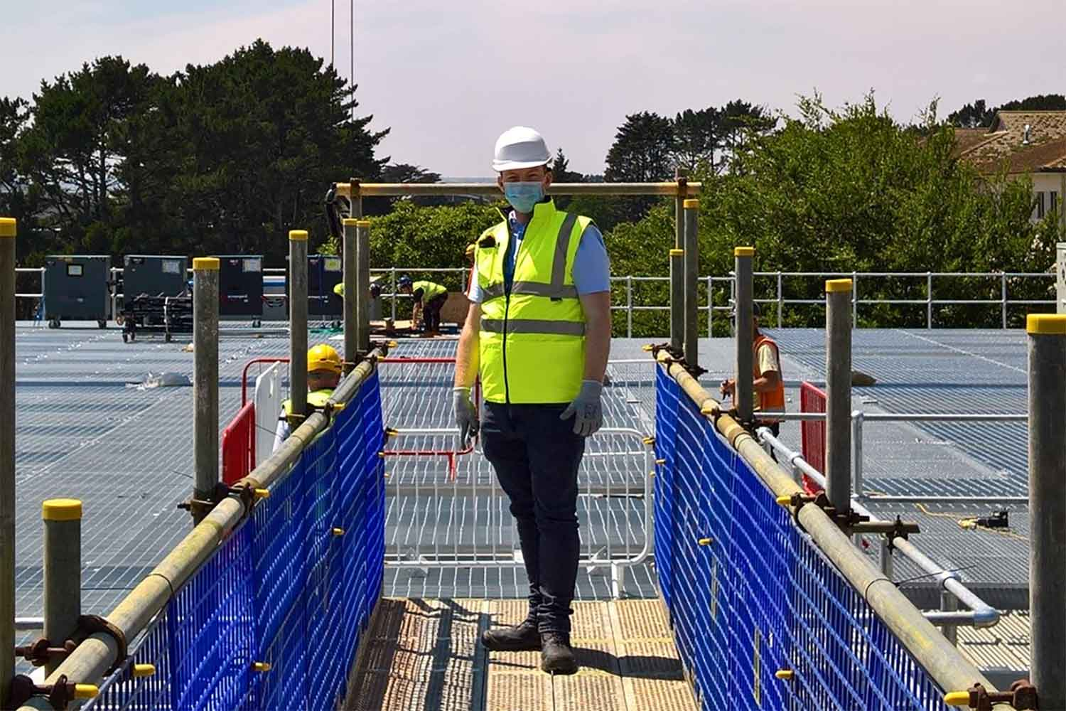James Angliss in high visibility clothing at building project site
