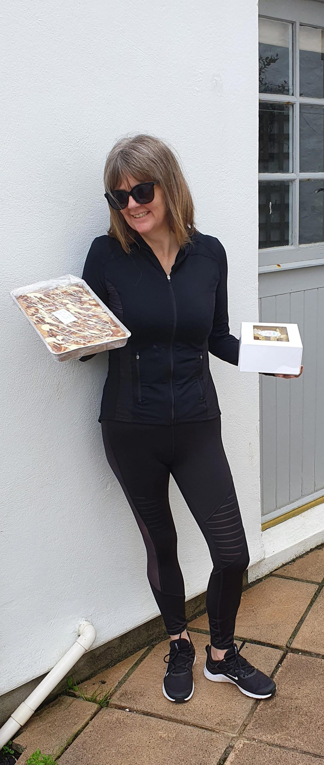 Lady holding boxes of food