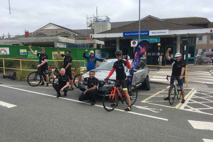 Cyclists gathered at the entrance to Royal Cornwall Hospitals Trust