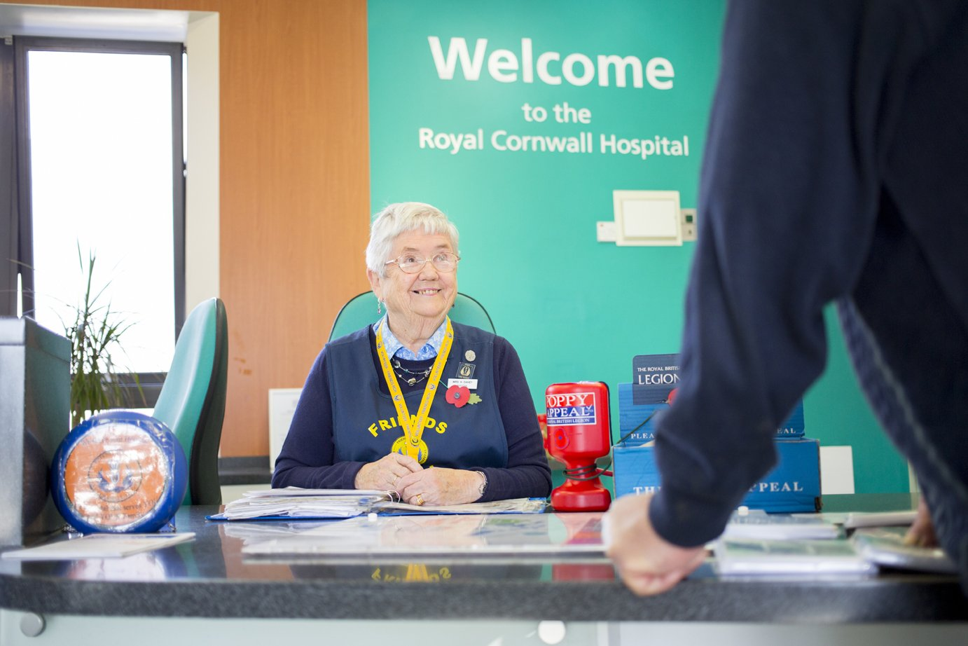 Royal Cornwall Hospital Friends Volunteer on reception