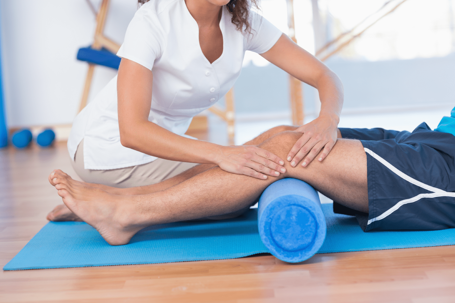 Clinician doing physiotherapy on a patient's knee