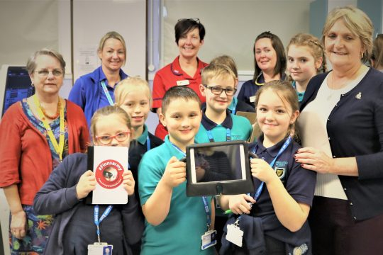 iPad donations from the charity Finnsarmy delight young visitors to Clinical Imaging