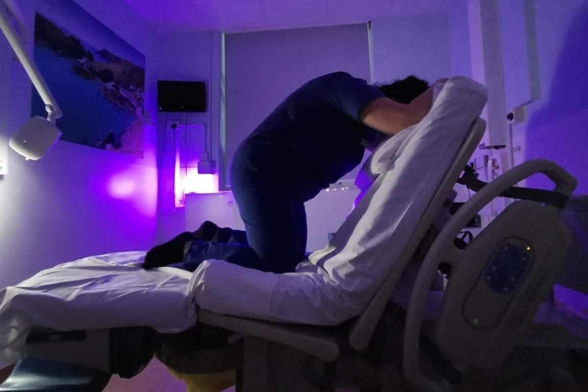 Nurse adjusting hospital bed