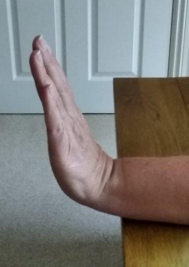 Person straightening their wrist upwards